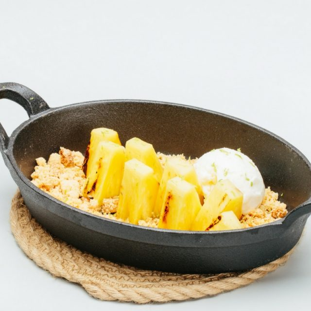 Josper-grilled pineapple with rum & lime syrup, powdered almonds and white chocolate icre cream