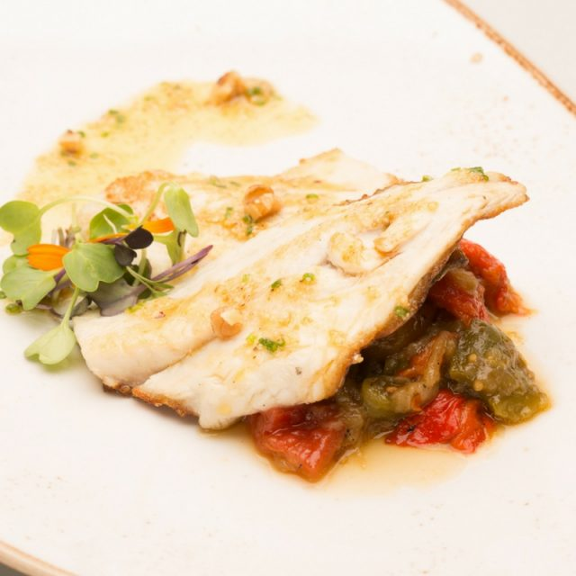 Gilt-head bream on roasted vegetables with nut oil