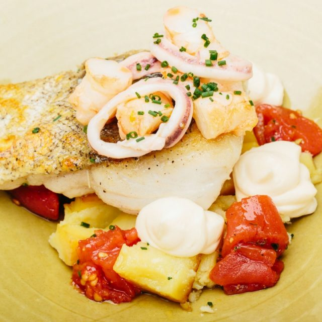 Josper-baked hake with sautéed squid and shrimp