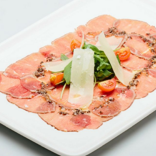 Smoked beef loin carpaccio in truffle oil with rocket and Parmesan